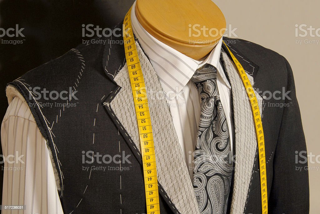 Tailor shop mannequin with measuring tape across neck. stock photo