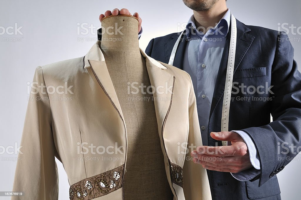 Tailor shows female jacket on mannequin torso stock photo
