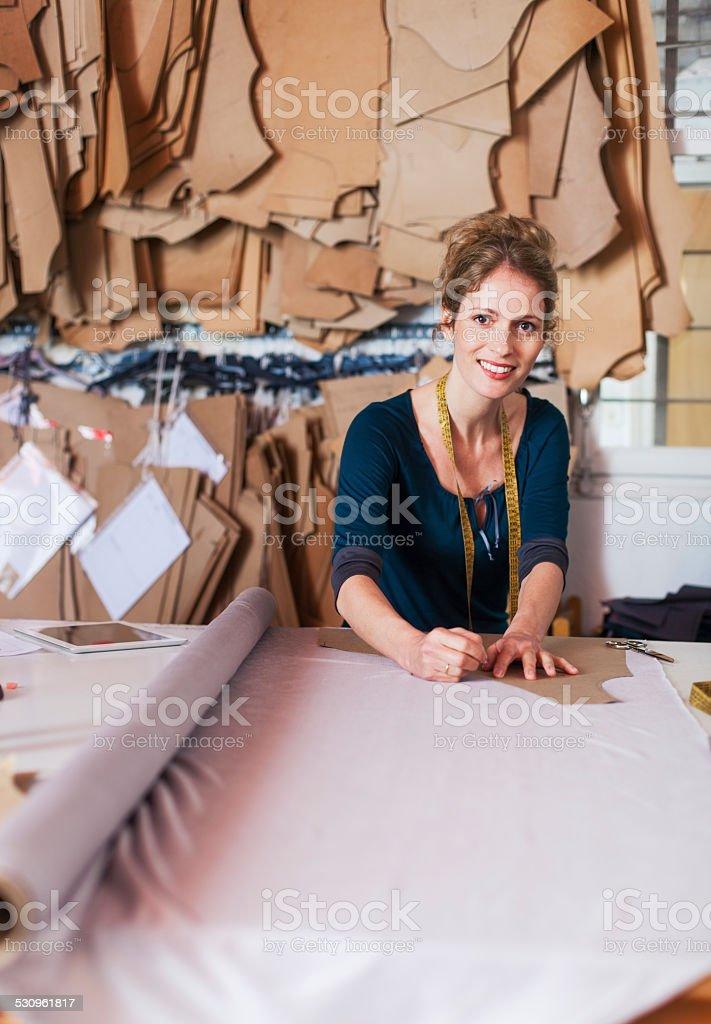 Tailor studio, fashion designer at work. stock photo