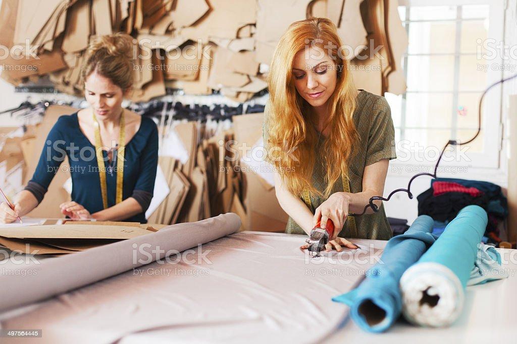 Tailor studio, fashion designers at work. stock photo