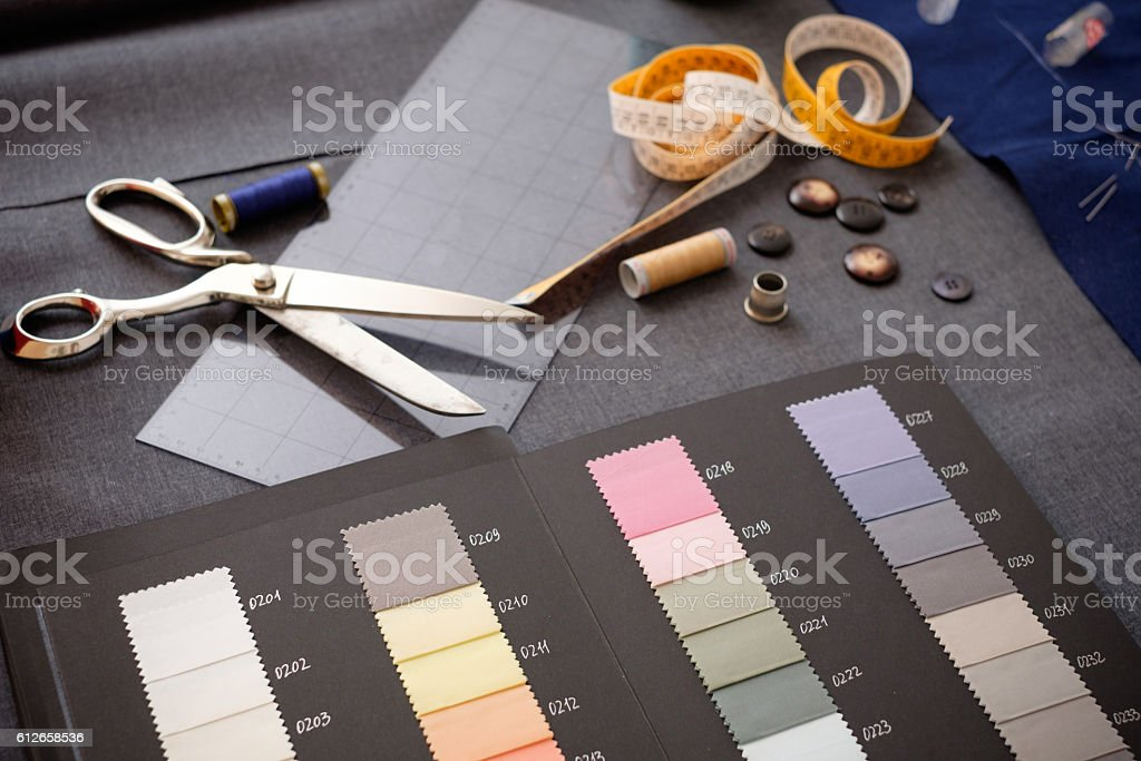 Tailor tools isolated on textile background stock photo