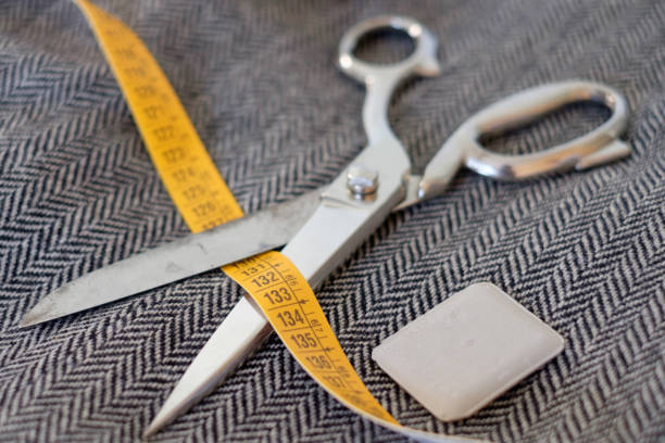 Tailor tools isolated on textile background Tailor tools isolated on textile background sailor suit stock pictures, royalty-free photos & images