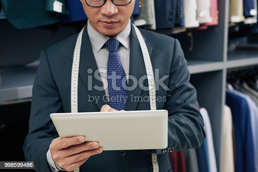 istock Tailor with digital tablet 998599486
