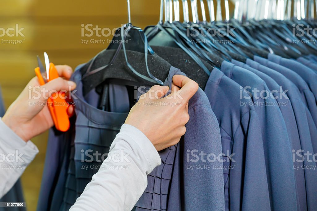 Tailor working at a textile factory stock photo