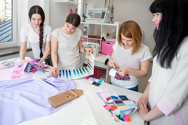 tailors choose the fabric for the dress stock photo