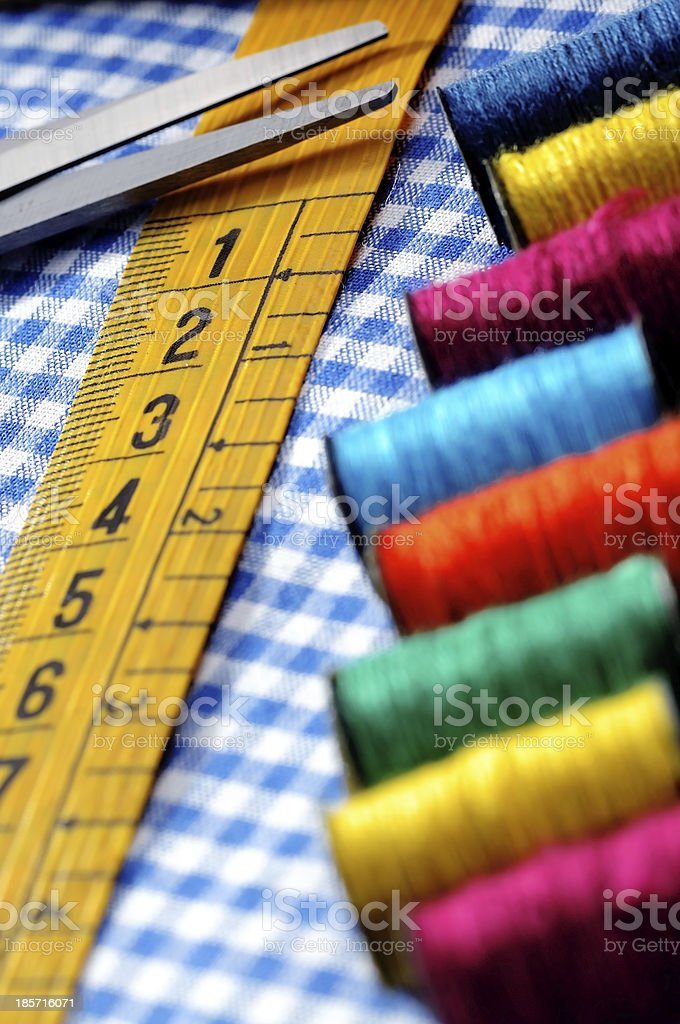 tailor's measuring tape and scissor royalty-free stock photo