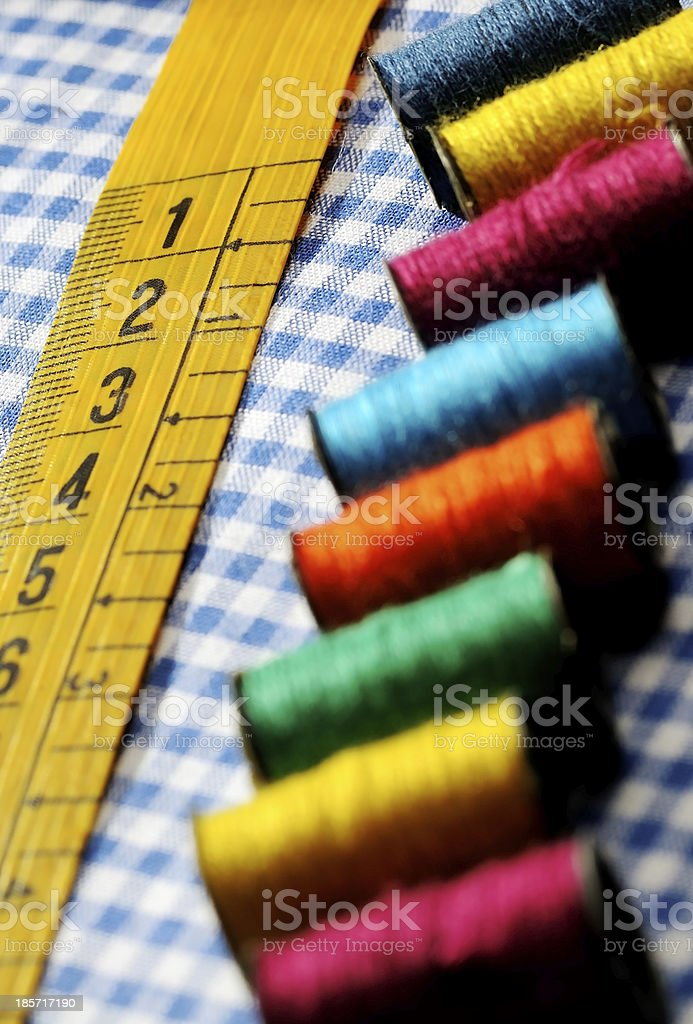 tailor's measuring tape and spools royalty-free stock photo