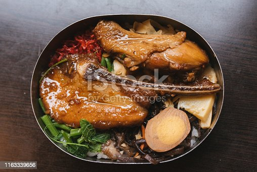 Image of Chinese pork chop consisted of rice in lunchbox. Taiwan famous Railway Bento Box.