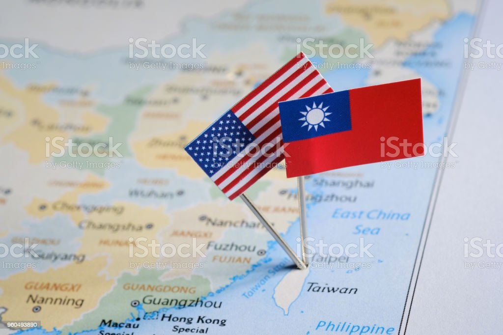 Taiwanese and American flags pinned on the map Concept TAIWAN-AMERICAN RELATIONS  For the Inspector. When I created this photo, I used the public domain map http://www.freemapviewer.com/en/map/Map-China_60.html American Flag Stock Photo