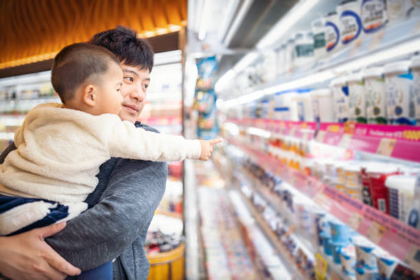 Taiwanese father and son shopping in a supermarket stock photo
