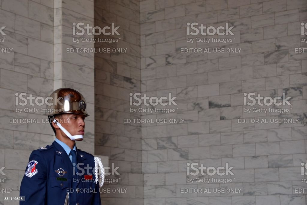 A Taiwanese guard was standing still stock photo
