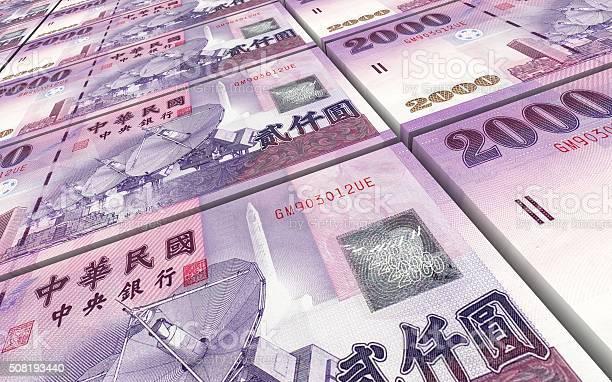 Taiwanese yuan bills stacks background.