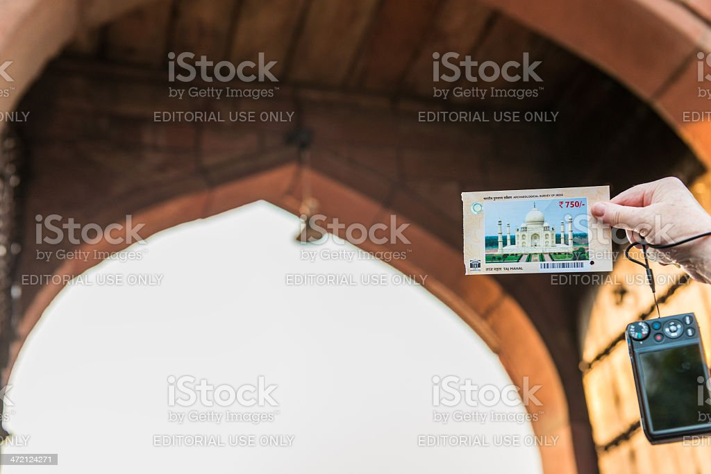 Taj Mahal Admission Ticket Held by Tourist royalty-free stock photo