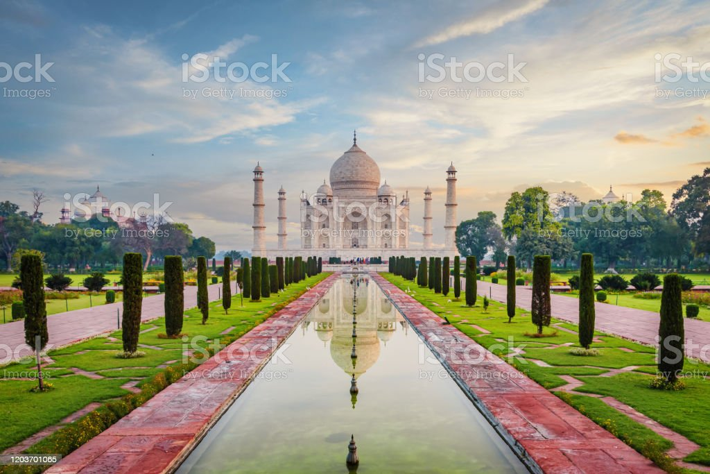 Taj Mahal Agra Moody Sunrise Twilight Relections India The famous Taj Mahal Mausoleum with reflection in the pond under moody sunrise twilight skyscape. The Taj Mahal is one of the most recognizable structures worldwide and regarded as one of the eight wonders of the world. Agra, India, Asia. Agra Stock Photo