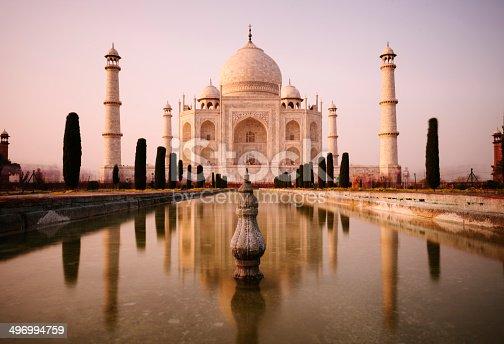 Motion blurred tourists move past the Taj Mahal at dusk, Agra, India