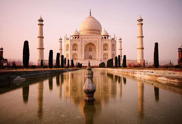 Taj Mahal, Agra Motion blurred tourists move past the Taj Mahal at dusk, Agra, India taj mahal stock pictures, royalty-free photos & images