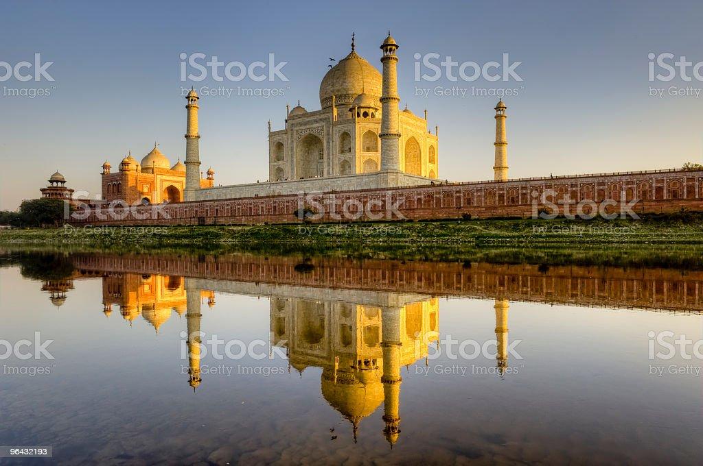 Taj Mahal and its reflection in Yamuna river, HDR stock photo