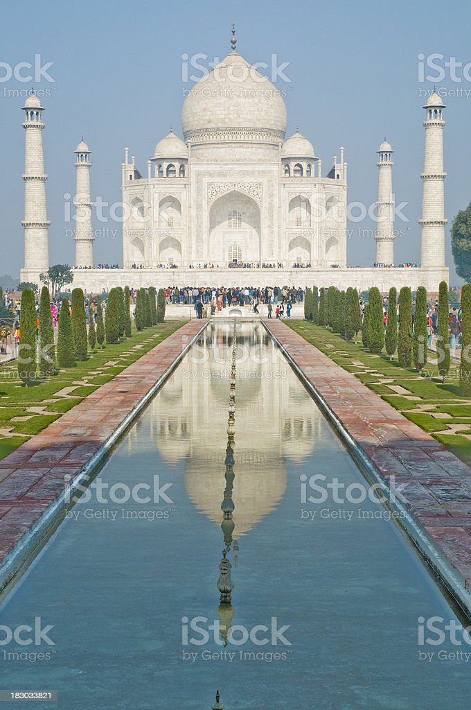 "Taj Mahal and it's reflection ""The Taj Mahal, is a mausoleum located in Agra, India. It is one of the most recognizable structures in the world. It was built by Mughal emperor Shah Jahan in memory of his third wife, Mumtaz Mahal.The Taj Mahal is an Unesco World Heritage site"" Agra Stock Photo"