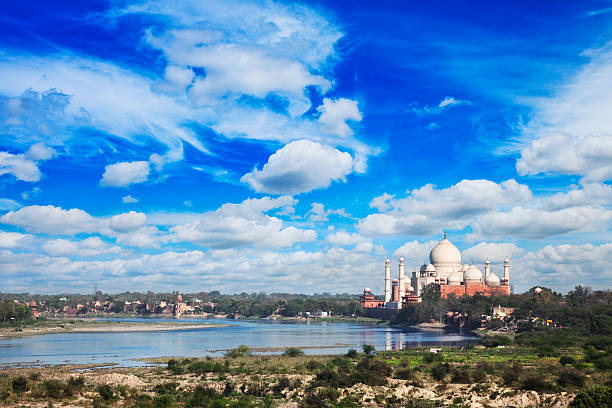 Taj Mahal and Yamuna River in Agra, India The Taj Mahal and Yamuna River in Agra, India. agra stock pictures, royalty-free photos & images