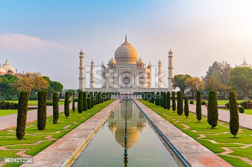 istock Taj Mahal front view reflected on the reflection pool. 962421230