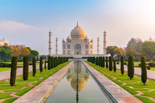 taj mahal front view reflected on the reflection pool. - india stock pictures, royalty-free photos & images