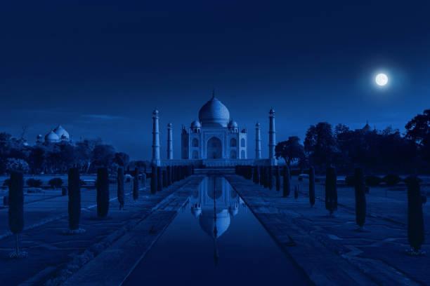 Taj Mahal in Agra, India in the light of the full moon Taj Mahal, monument in Uttar Pradesh taj mahal stock pictures, royalty-free photos & images