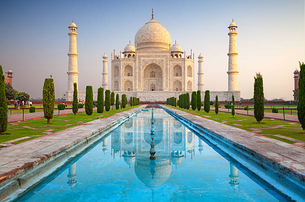 Taj Mahal in Agra, India Agra, India - October 11, 2016: Facade view of Taj Mahal in Agra, India. It was commissioned in 1632 by the Mughal emperor, Shah Jahan (reigned 1628–1658), to house the tomb of his favourite wife, Mumtaz Mahal. agra stock pictures, royalty-free photos & images