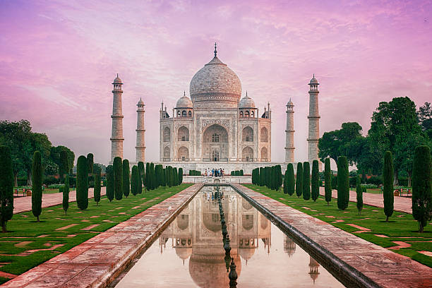 Taj Mahal, India The Taj Mahal is a mausoleum located in Agra, India. It is one of the most recognizable structures in the world. Taj Mahal is regarded as one of the eight wonders of the world. agra stock pictures, royalty-free photos & images