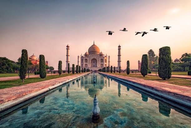 Taj Mahal mausoleum in Agra Taj Mahal in sunrise light, Agra, India taj mahal stock pictures, royalty-free photos & images