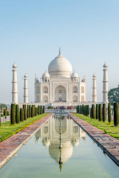 Taj Mahal Monument Agra, India The famous Taj Mahal mausoleum with reflection in the pond, is one of the most recognizable structures worldwide and regarded as one of the eight wonders of the world. Clear blue sky, empty site without people. City of Agra, India. taj mahal stock pictures, royalty-free photos & images