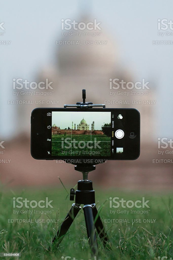 Taj mahal on smartphone stock photo