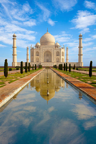 Taj Mahal Taj Mahal and reflecting pool, Agra, Uttar Pradesh, India. taj mahal stock pictures, royalty-free photos & images
