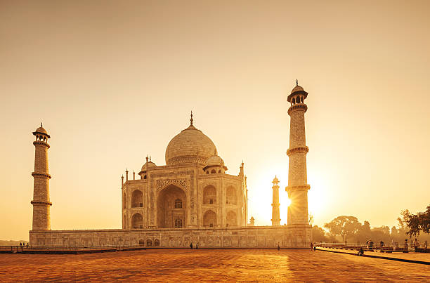 Taj Mahal Sunset, India The Taj Mahal is a mausoleum located in Agra, India. It is one of the most recognizable structures in the world. Taj Mahal is regarded as one of the eight wonders of the world. taj mahal stock pictures, royalty-free photos & images