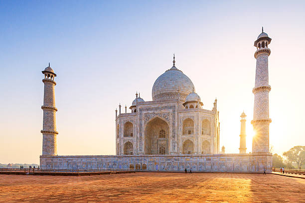 Taj Mahal Sunset The Taj Mahal is a mausoleum located in Agra, India. It is one of the most recognizable structures in the world. Taj Mahal is regarded as one of the eight wonders of the world. taj mahal stock pictures, royalty-free photos & images