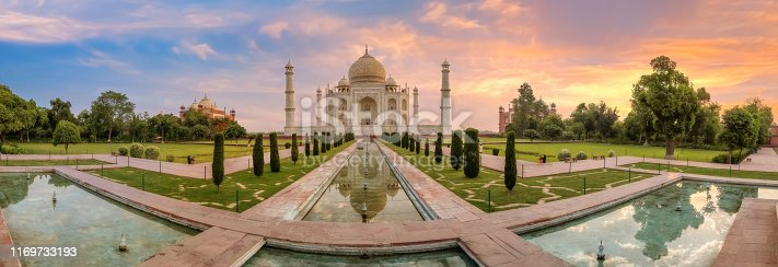 Taj Mahal Agra panoramic view at sunrise. Taj Mahal is a UNESCO World Heritage site at Uttar Pradesh India.