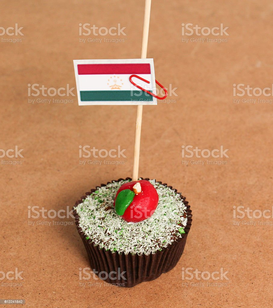 tajikistan flag on a apple cupcake stock photo