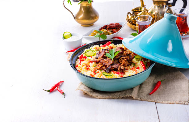 Tajin with couscous, vegetables and meat on white background – zdjęcie