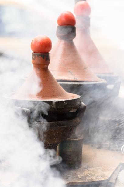 Tajine pots on the fire - foto stock