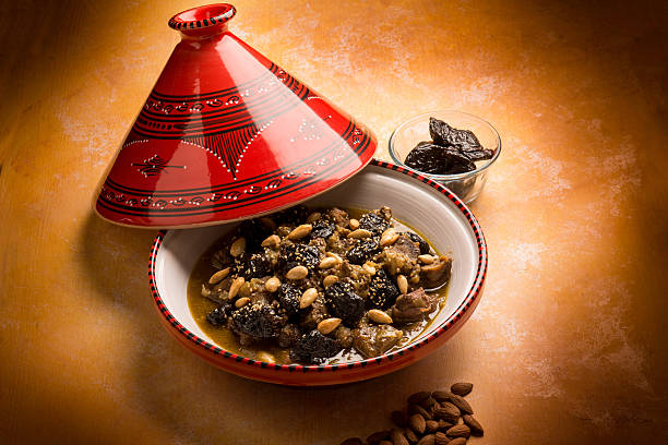 tajine with meat plum almond - tagine stock-fotos und bilder