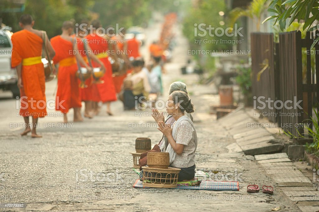 Tak Bat procession on the street of Luang Prabang, Laos. stock photo