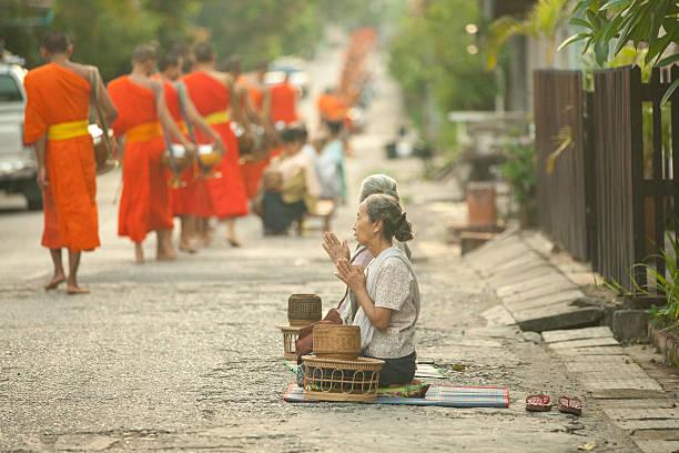 Tak Bat procession on the street of Luang Prabang, Laos. stock photo