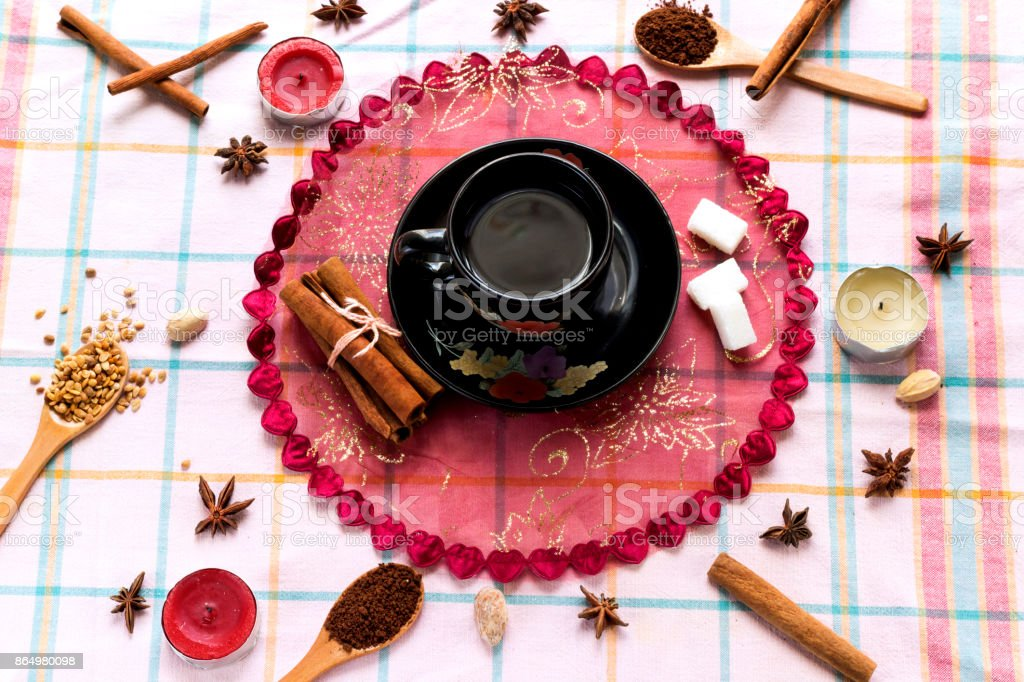 take a arabic coffee cup aromatic cinnamon stick on wood table decorate star anise  and candle stock photo