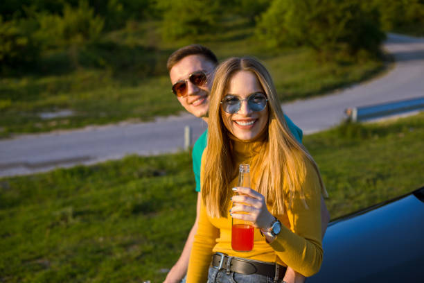 Take a break, have a drink enjoy sunset and smile stock photo