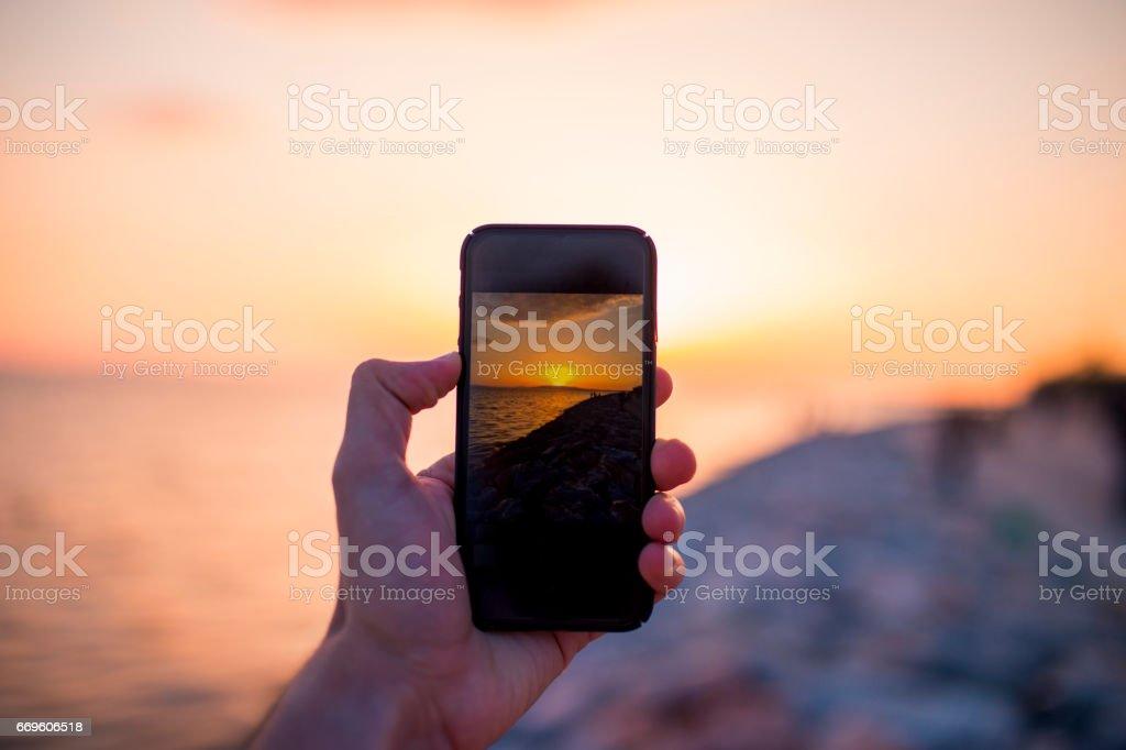 Nehmen Sie ein Foto am Strand – Foto