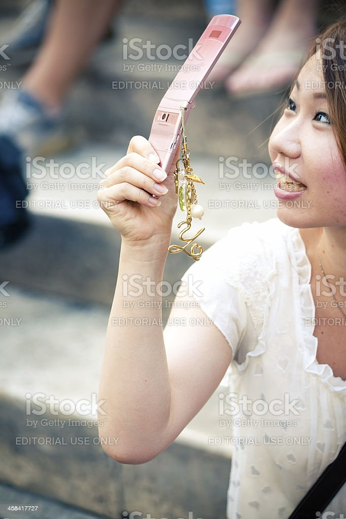 Take a picture with mobile phone royalty-free stock photo