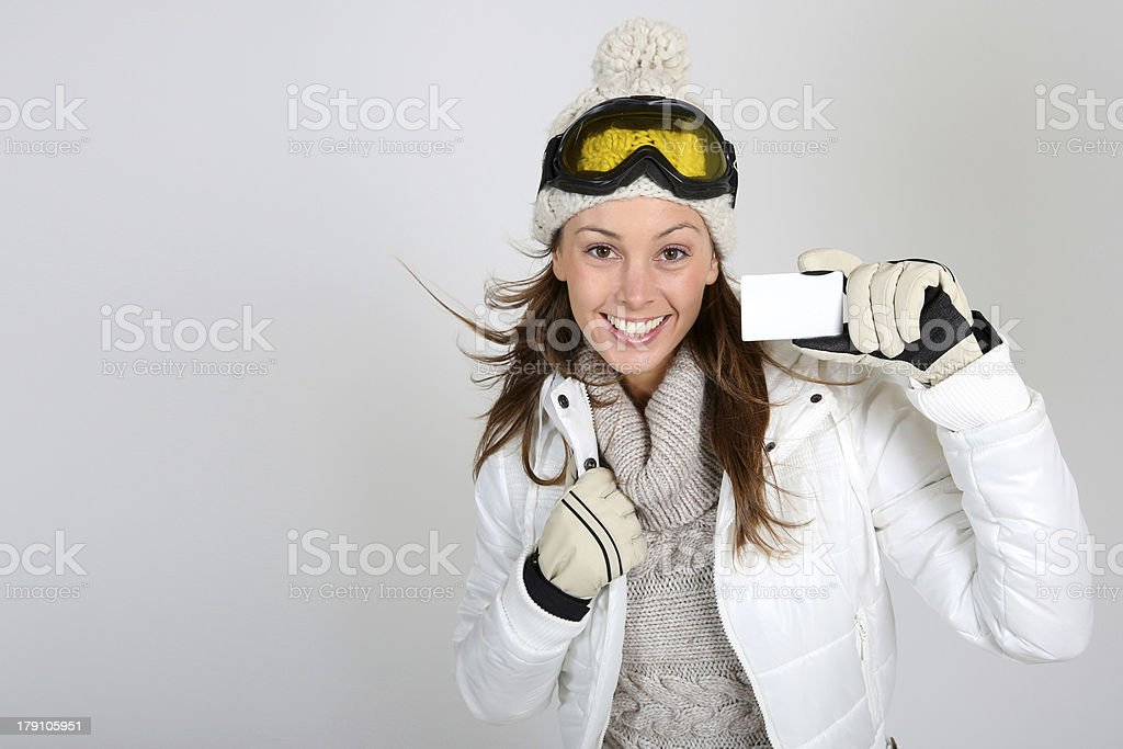 Take a ski pass like this happy woman royalty-free stock photo