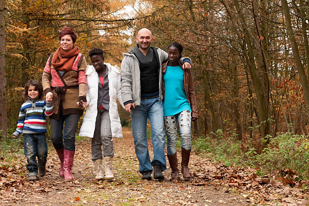 Take a wlk with themulticultural family stock photo