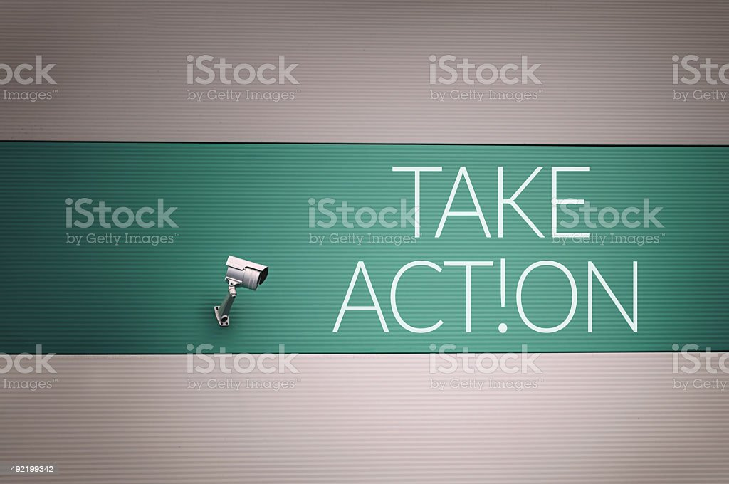 Take action text on wall stock photo