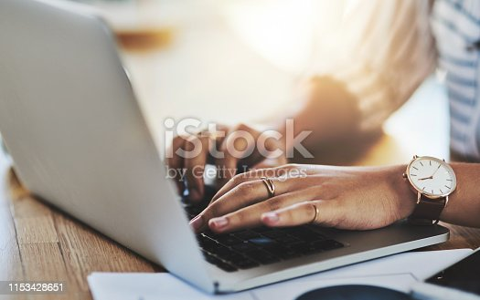Shot of an unrecognizable businesswoman working on a laptop in her office