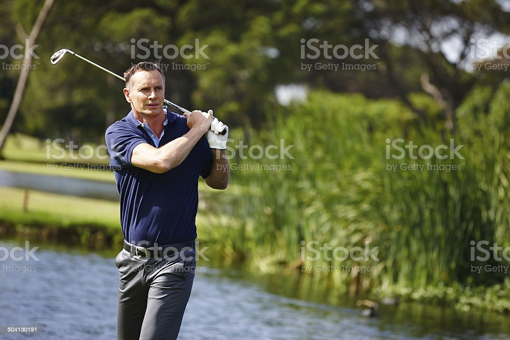 Take another swing at it stock photo